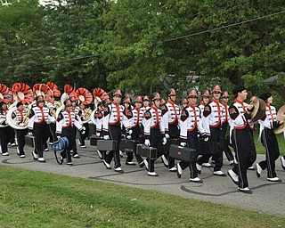 The Howland High School Marching Band marches into the stadium and past the Blitz party on Friday, Sept. 16, 2011.