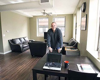 Phil Kidd enjoys his downtown Youngstown apartment in the Federal Building at Phelps and West Federal streets. Kidd, who works on neighborhood engagement and organizing issues for the Mahoning Valley Organizing Collaborative, is one of Youngstown's most vocal and visible boosters. Kidd was the last tenant at the Federal Building, moving in last month.
