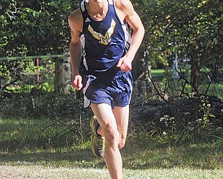 McDonald's Pat Kunkel finished sixth to help the Blue Devils win the Division III boys portion of the Spartan Invitational in Boardman.