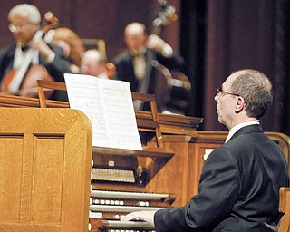 American organist David Higgs plays Stambaugh Auditorium's restored organ during a rededication concert Sunday. Higgs was the guest organist and played alongside the Youngstown Symphony Orchestra.