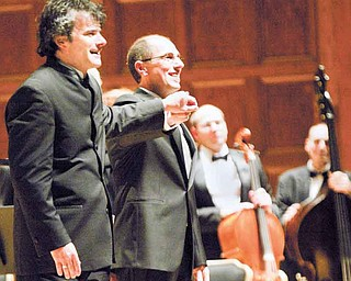 Randall Craig Fleischer, left, conductor for the Youngstown Symphony Orchestra, and David Higgs, organist from the Eastman School of Music in Rochester, N.Y., turn toward hundreds of people in the crowd at Stambaugh Auditorium on Sunday. The concert also celebrated the 80th anniversary of the Youngstown Symphony Orchestra.