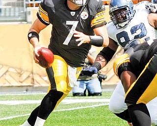 Pittsburgh Steelers quarterback Ben Roethlisberger (7) scrambles away from Seattle Seahawks defensive tackle Brandon Mebane (92) in the first quarter of an NFL football game on Sunday, Sept. 18, 2011, in Pittsburgh. (AP Photo/Keith Srakocic)