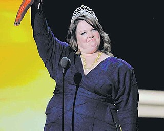"""Melissa McCarthy accepts the award for outstanding lead actress in a comedy series for  """"Mike and Molly""""at the 63rd Primetime Emmy Awards on Sunday, Sept. 18, 2011 in Los Angeles. (AP Photo/Mark J. Terrill)"""