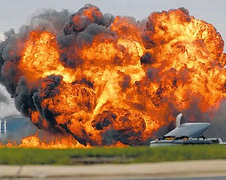 A single engine T-28 from the six-plane Trojan Horsemen Demonstration Flight Team crashes and explodes during a performance at the Thunder Over the Blue Ridge Open House and Air Show, Saturday, Sept. 17, 2011 at the 167th Airlift Wing in Martinsburg, W.Va. (AP Photo/Journal Newspaper, Ron Agnir)