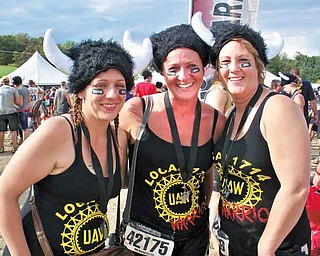 Wendy Fry-Mcmurray of Boardman, Kasey King of Austintown and Tammy Metzgar-Daggy of Salem wear warrior hats Sept. 10 at the Warrior Dash Ohio II in Carrollton, Ohio. More than 10,000 people completed 12 obstacles during the 3.1-mile course.