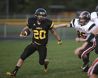 ROBERT  K.  YOSAY  | THE VINDICATOR --..Missed as Crestvies #20 Kris Simpson moves quickly oout of the outstretched arms of #25 Christian Feezle  as Kris scampered for  a  first quarter  First Down  as the Crestview Rebels hosted the Springfield Tigers at Crestview Stadium ..--30-..(AP Photo/The Vindicator, Robert K. Yosay)