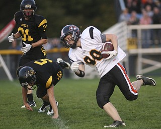 ROBERT  K.  YOSAY  | THE VINDICATOR --..Springfield Tigers #80 Jeremy Weingart  takes off as Crestviews #5 Dillon Gorby and #31 Tom Oliver look on - Jeremy was stopped after a few yards as the Crestview Rebels hosted the Springfield Tigers at Crestview Stadium ..--30-..(AP Photo/The Vindicator, Robert K. Yosay)