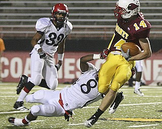 JESSICA M. KANALAS | THE VINDICATOR ..Mooney's senior wide receiver Ryan Farragher fights off the Red Lion Christian Academy's junior defensive back HakeemHarriott during the first quarter of Saturday night's game at YSU stadium. ..-30