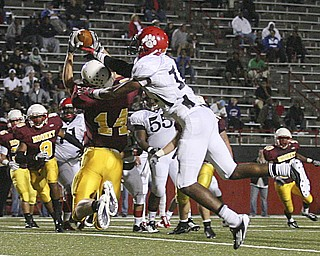 JESSICA M. KANALAS | THE VINDICATOR ..Mooney's senior wide receiver Ryan Farragher intercepts the ball from a pass intended for junior wide receiver Neiko Creamer of the Red Lion Christian Academy during the second quarter of Saturday night's game at YSU stadium. ..-30