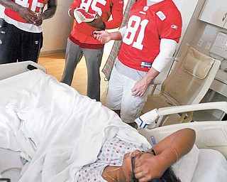 San Francisco 49ers players, from left, Delanie Walker, Vernon Davis and Justin Peelle visit patient Teasia Tarver, 15, of Youngstown at the Akron Children's Hospital Mahoning Valley in Boardman.