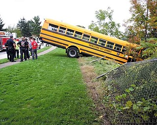 "Police and Youngstown City Schools officials are investigating a one-vehicle school bus accident on the West Side on Monday afternoon. No children were on the bus marked ""67"" when the bus went over an embankment at about 2:30 p.m. and hit a tree just above Interstate 680 near Wellington and Maryland avenues. Winnie Timpson, chief of transportation for the schools, said the driver hit the curb and then panicked, hitting the gas and going over the embankment. The female driver was not injured in the accident."