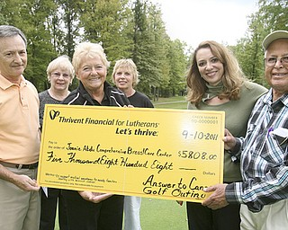 "JESSICA M. KANALAS | THE VINDICATOR ..Chris Partika, committee member; Jack Nock, Mahoning Co. chapter of Thrivent Financial; Marilyn Johnson, committee member; Lynne Grischow, committee chair and Bedford Trails owner; Sherry Giovanni, committee member; ..present check for $5,808 to..Gina Marinelli, HMHP Foundation; Dr. Rashid Abdu, honorary chairman of the campaign for the Joanie Abdu Comprehensive Breast Care Center..**92 golfers attended ""Answer to Cancer"" golf outting on September 10...-30"