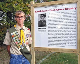 JESSICA M. KANALAS | THE VINDICATOR ..Senior at Austintown Fitch Alexander While created a commemorative sign that was placed in Austintown Township Park that remembers Ed Wilhelm, a Fitch alumni, who died in Texas trying to save the life of a stranger who was drowning.