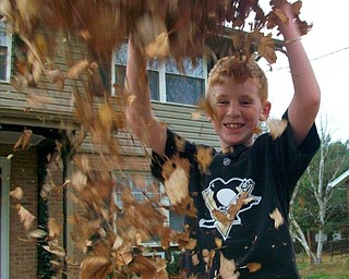 June Carr of New Castle, Pa., sent in this photo of her grandson Andy, who was throwing leaves on his mom, Janet, who took this action shot as it was happening.