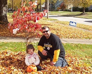 Is that practice for trick-or-treating? Mikayla Upright takes a break from stuffing her pumpkin with leaves with her Uncle Josh Upright. Both are from Boardman. Photo sent in by Sheree Savon of Youngstown.