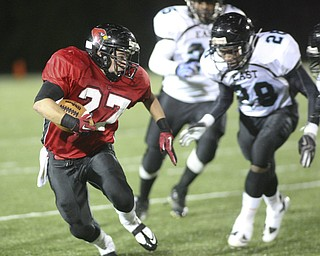 ROBERT K. YOSAY | THE VINDICATOR..Canfield #27    Ben Angelo makes the cut in front #28  East - Daveon Harris  #25 Juwan  Madison ..East  Panthers at Canfield Cardinals .....-30
