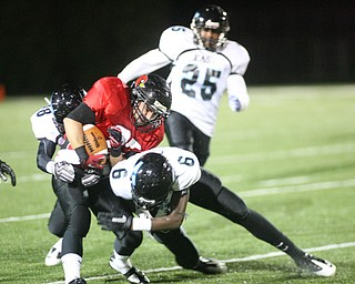 ROBERT K. YOSAY | THE VINDICATOR..#27   Ben Angelo   is stopped by #9 Antwain Stuart   behind him is #25  Juwann Madison ..East  Panthers at Canfield Cardinals .....-30