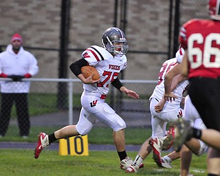 Defensive linemen Nate Middleton returns an interception down inside the Struthers 10 yardine.