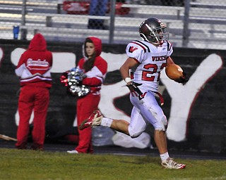 Running back Matt Szorady #22 of Labrae runs down the sideline for the 60+ yard touchdown.