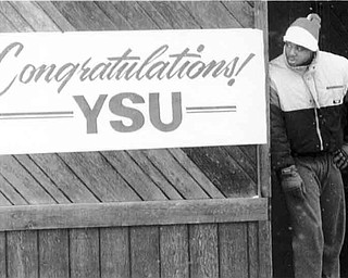 01/17/91 - Doug Oster.YSU player, Aaron Green waits on 5th Ave. for the parade to start. Green was waiting to get on the float with the rest of the players.