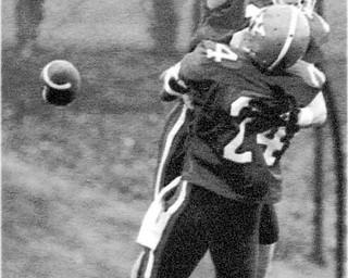 01/17/91 - Doug Oster.YSU vs Villanova: YSU wins - Dave Roberts of YSU celebrates scoring a TD with #24 Herb Williams. This was YSU's first score.
