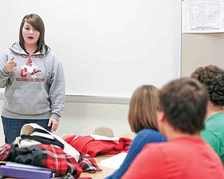 Canfield High School senior Kaylee Kapalko gives an impromptu speech Monday during the team's after-school practice.