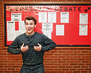 Junior Nathan Pecchia shows off one of the poses he uses while competing in duo interpretation for the Canfield High School speech team. He finished second at state competition with his partner, Rosie Jo Neddy.