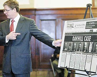 John F. McCaffery, a lawyer for two Cafaro Co. affiliates, points Monday to a page from The Vindicator's vindy.com website, which prominently displays the former defendants in the now-dismissed Oakhill Renaissance Place criminal case. He is questioning Barbara Paynter, a Cleveland public-relations practitioner, about the negative publicity generated by the indictment.