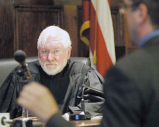 Visiting Judge William H. Wolff Jr. listens intently during a Monday hearing on whether records in the dismissed Oakhill Renaissance Place criminal conspiracy case should be sealed from public view.