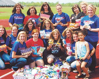Team donates supplies to female troops: Members of the Western Reserve High School 2011 softball team participated in its second annual service learning project, this year donating supplies for female military troops serving overseas. Coach Stephanie Wallace oversaw the project, collected all of the items from the girls and their families, and sent more than 180 items to the USO of Northern Ohio to be packaged and delivered. Other coaches are Laura Amero, Jen Paris and Gene Bogden.