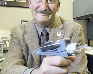 "A ""Star Trek: The Next Generation"" buff , Matthew A. Stefanak III, retiring as health commissioner of the Mahoning County District Board of Health, shows off his Star Trek replica phaser. In announcing his retirement to the staff , he said: ""The captain has decided to relinquish command of the star ship."""
