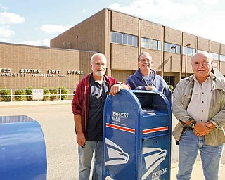 Chuck Myers, left, Doug Lammert and Dan Napolitan were all hired as electronic technicians Sept. 13, 1986. The three combined have 75 years of experience. They could all lose this jobs if the U.S. Postal service decides to close the distribution and processing center in downtown Youngstown.