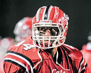 Struthers running back Dave Stewart (44) wears a football helmet outfi tted with Shockstrips™, a patent-pending sports product developed by Dr. Steven D. Novicky and his wife, Kim, of Canfield, which may help prevent brain injuries in young athletes by raising the level of protection provided by virtually any helmet, be it for football, hockey, baseball, lacrosse or cycling.