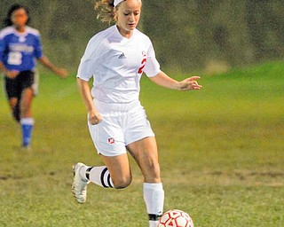 Mooney's #2 Amy Vinopal moves the ball up field during a game with CVCA.