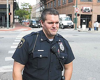 Youngstown patrolman Michael Cox said most people are glad to see uniformed officers walking the streets of downtown during the day.