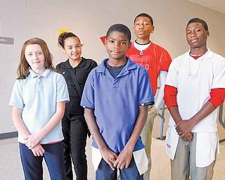Volney Rogers Academy students, from left, Hannah Coleman, a sixth-grader; Markyra Ortello, seventh-grader; Shannon Dubose, sixth-grader; and Elijah Anderson and Rontelli Reed, both seventh-graders; sported their clothing inside-out Wednesday. The inside-out day was part of the school's efforts to maximize student attendance during Average Daily Membership week, which runs through Friday.