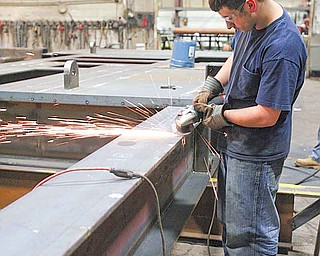 JESSICA M. KANALAS | THE VINDICATOR..Specialty Fab employee Bill Shilott grinding .. something.. Karl said he'd fill in captions.. ..-30