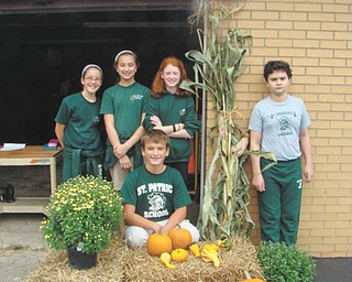 SPECIAL TO THE VINDICATOR: The seventh-grade class at St. Patrick School in Hubbard is having its annual fall sale through Oct. 14 at the rectory garage, next to the school. The students, including standing, from left to right, Marie Bond, Sophie Madeline, Katie Fagundus and Greg Conners, and kneeling, Nathian Eigiacobbe, are selling items every day from 2:40 to 3:05 p.m. Items for sale include pumpkins for $3, $5 and $6; cornstalks for $2.50; bales of straw for $4; assorted mums for $5; gourds and jack-be-littles are two for $1; and 5-pound bags of red potatoes are $2.50. Proceeds will help pay for the students' spring trip to Camp Fitch. For information call the school at 330-534-2509.