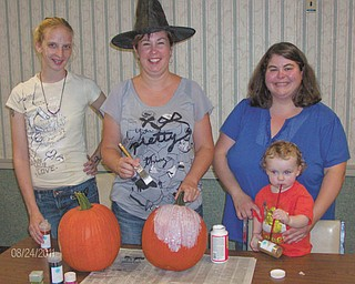 SPECIAL TO THE VINDICATOR | Fundraiser filled with fun: Parents of students at the Rich Center for Autism are inviting the public to an evening of Halloween fun while supporting a worthy cause. Masquerade for Autism will take place from 7:30 to 10:30 p.m. Oct. 21 at Antone's Banquet Center, 8578 Market St., Boardman. The cost for the fundraiser is $35 per person and includes Halloween treats and appetizers, music, dancing, fun photos and auctions. Costumes are encouraged, but not mandatory. Checks should be sent to the Rich Center for Autism, One University Plaza, Youngstown, OH 44555. For information call the center at 330-941-1927. Pictured are, from left, committee members Michelle McDonald, Jenny Ellis and Beckey Henry (with her son Liam).