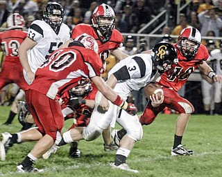 FOOTBALL - (3) Adam Coppock tries to beat the Columbiana defense led by (40) Brandon Hacker and (10) Austin Barbato Friday night. - Special to The Vindicator/Nick Mays