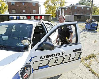 Liberty policeman Sgt. Daniel Kovach inspects a vacant, southside apartment. As the line between the township and Youngstown blurs, drug-related crimes over the past decade have increased.