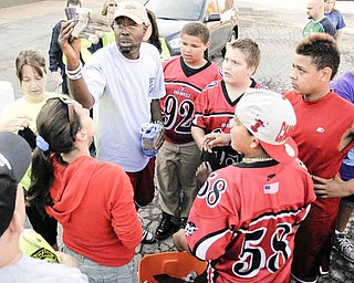 Gerald Hamilton hands out gloves to voulenteers.