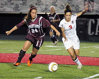 SOCCER - (24) SueJude Hamdan of Boardman battles (3) Paige Bidinotto of Canfield for the ball during thier game Saturday night in Canfield. - Special to The Vindicator/Nick Mays