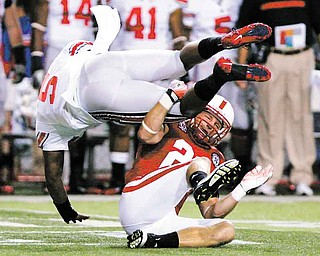 Ohio State quarterback Braxton Miller (5) is upended by Nebraska's Lance Thorell in the first half of an NCAA college football game in Lincoln, Neb., Saturday, Oct. 8, 2011. (AP Photo/Nati Harnik)