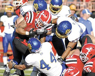 Youngstown State running back #35 Jamaine Cook is tackled by South Dakota State defenders #44 Ross Shafrath, #46 Jake Steffen, #27 Je Ryan Butler, and #22 Anthony Wise.