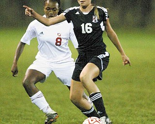 Mooney's Lindsey Parkins closes in on Canfield's Kaylee Buchenic (16) during Monday's game. Parkins scored the gamewinning goal for Mooney. Buchenic had an assist for Canfield.