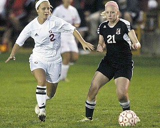 Mooney's Amy Vinopal, left, and Canfield's Erin McGraw go for the ball during Monday's game at the Simon Soccer Park in Struthers. Vinopal scored two goals and assisted on the game-winning goal in Mooney's 3-2 victory.