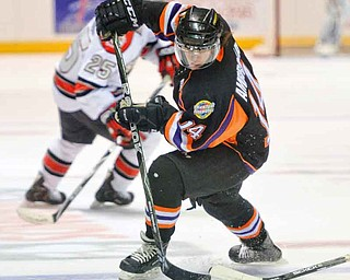 The Youngstown Phantoms Mike Ambrosia (14) moves the puck during a game against the Chicago Steel. Ambrosia, who score 10 goals and had 18 assists last season, is returning to the ice on the Phantoms' top line  with 21-goal scorer Ryan Belonger (16), and newcomer Auston Cangelosi.