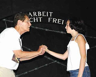 """Thomas Lee Ewen and Grace Off erdahl rehearse a scene from """"A Light in the Darkness"""" at Victorian Players Theater."""