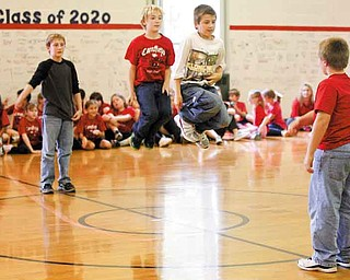 Fourth-grade students Logan Brown, Jacob Kuszaj, Alex George and Gavin Tareshawty show off their jump-roping skills during C.H. Campbell Elementary School's kickoff assembly for Jump Rope For Heart fundraiser. The school has participated in the American Heart Association's fundraiser since 1997.